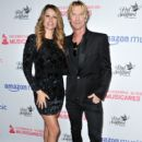 Susan Holmes and Duff McKagan attend the MusiCares Concert For Recovery presented by Amazon Music, Honoring Macklemore at The Novo by Microsoft on May 16, 2019 in Los Angeles, California - 399 x 600