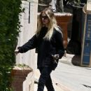 Ashley Benson – Returns home with her boyfriend in Los Angeles