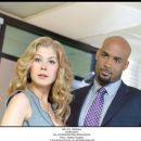 Rosamund Pike as Maggie Greer and Boris Kodjoe as Anthony Stone in Touchstone Pictures' Surrogates. © Touchstone Pictures, Inc. All Rights Reserved.