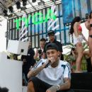 Tyga performs during DAYLIGHT Beach Club's grand opening weekend at the Mandalay Bay Resort and Casino on March 26, 2017 in Las Vegas, Nevada - 454 x 586
