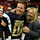 J.J. Raterink is congratulated by Motley Crue singer and team owner Vince Neil after the Outlaws defeated the Los Angeles Kiss 49-16 during their game at the Thomas & Mack Center on May 4, 2015 in Las Vegas, Nevada.