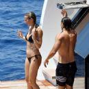 Gwyneth Paltrow in Black Bikini on a luxury yacht in Capri