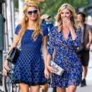 Paris and Nicky Hilton are all smiles as the two head out for lunch in New York City, New York on September 7, 2014