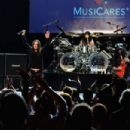 (L-R) Musicians Billy Morrison, Ozzy Osbourne, Tommy Clufetos and Slash perform onstage at the 10th annual MusiCares MAP Fund Benefit Concert at Club Nokia on May 12, 2014 in Los Angeles, California.