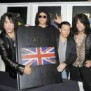 "Tommy Thayer, Gene Simmons, Paul Stanley and Eric Singer at the ""KISS Monster"" book launch at the Arts Club, Mayfair, London, England"