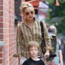 Kate Hudson rides on son Ryder's scooter as the mother-son duo spend time together while out in NYC