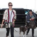 Kate Upton and her dog at LAX Airport in Los Angeles - 454 x 681