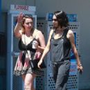 Mila Kunis in Black Overalls – Shopping in Los Angeles