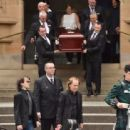 Angus Young at the funeral service for AC/DC co-founder Malcolm Young at St Mary's Cathedral on November 28, 2017 in Sydney, Australia - 454 x 312