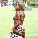 Joanna Krupa – Bodypaint while protesting outside Westminster in London - 454 x 637