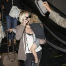 Ashlee Simpson with her son Bronx arrive at LAX airport in Los Angeles (July 27)