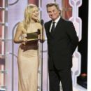 Kate Hudson and Kurt Russell speak onstage during the 73rd Annual Golden Globe Awards at The Beverly Hilton Hotel on January 10, 2016 in Beverly Hills, California
