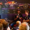Sebastian Vettel of Germany and Infiniti Red Bull Racing and Daniel Ricciardo of Australia and Infiniti Red Bull Racing speak with David Coulthard at a press conference before a show run along North Congress Avenue during previews ahead of the United Stat