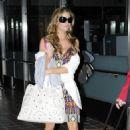 Denise Richards Arrives At LAX, July 8, 2010