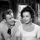 James Arness & Kasey Rogers in The Two Lost Worlds