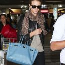 Rosie Huntington-Whiteley Lands in Sao Paulo