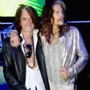 Joe Perry and Steven Tyler attend the Roberto Cavalli show during the Milan Menswear Fashion Week Spring Summer 2015 on June 24, 2014 in Milan, Italy.