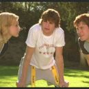 Brittany Murphy (left), Ashton Kutcher (center) and Christian Kane (right) star in Shawn Levyl's Just Married, a 20th Century Fox release.