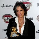Joe Perry poses with the Riff Lord Award at The Metal Hammer Golden Gods Awards at indigo O2 on June 14, 2010 in London, England.