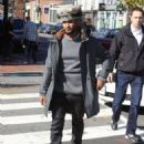 Singer Usher takes a morning stroll in Georgetown with his girlfriend Grace Miguel on November 11, 2014 in Washington, D.C