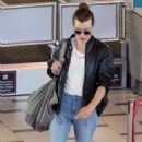 Milla Jovovich at Cape Town International Airport in South Africa - 454 x 748