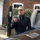 George Michael and partner Fadi Fawaz are seen leaving there home