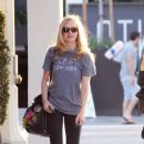 "Amanda Seyfriend, wearing a ""Spin New York"" gray t-shirt and leggings, leaves a hair salon in West Hollywood"