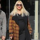 Gwen Stefani shows off her growing baby bump while doing some holiday shopping at Bloomingdales in Los Angeles, California on December 4, 2013