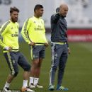 Zinedine Zidane (right) gives out instructions to his players with Deportivo La Coruna in their sights
