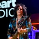 Recording artist Steve Stevens performs onstage during the first ever iHeart80s Party at The Forum on February 20, 2016 in Inglewood, California. - 422 x 600