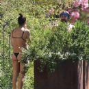 PICTURE EXCLUSIVE Irina Shayk displays her slender supermodel body in a black string bikini as she enjoys swim with shirtless hunky beau Bradley Cooper during romantic Lake Garda getaway