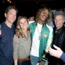 CEO of Fanatics Doug Mack, former professional soccer player Brandi Chastain and recording artists Wiz Khalifa and Jon Bon Jovi attend the Fanatics Super Bowl Party on February 6, 2016 in San Francisco, California.