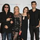 Musician Gene Simmons of Kiss, Shannon Tweed, Sophie Simmons and Nick Simmons attend the Spirit of Excellence Awards 2014 at the Hyatt Regency Century Plaza on September 23, 2014 in Century City, California.