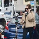 Ashley Tisdale – Takes her pup Ziggy to pick up food to go in Los Feliz