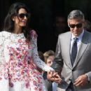 George Clooney & Amal Alamuddin spotted leaving The Aman Canal Grande Hotel for the first time as a married couple on Sunday (September 28) in Venice, Italy