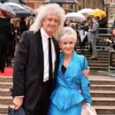 Brian May and Anita Dobson attend The Olivier Awards with Mastercard at Royal Albert Hall on April 8, 2018 in London, England - 399 x 600