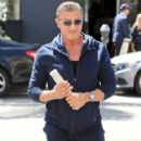 Sylvester Stallone poses with a group of fans while out running errands in Beverly Hills, California on March 28, 2017 - 417 x 600