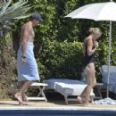 Caroline Wozniacki – In black swimsuit poolside in Portofino - 454 x 344