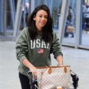 Michelle Keegan – Arriving at Heathrow Airport in London - 454 x 648