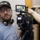 Director STEVEN SODERBERGH sets up his next shot on the set of Warner Bros. Pictures', Participant Media's and Groundswell Productions' offbeat comedy 'The Informant!,' a Warner Bros. Pictures release. Photo by Claudette Barius