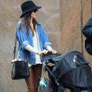 Model Miranda Kerr takes son Flynn out for a walk in New York City, NY on March 18, 2012