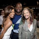 Gabrielle Union, Dwyane Wade and Steven Tyler attends the D'USSE VIP Riser and Lounge at On The Run Tour Chicago at Soldier Field on July 24, 2014 in Chicago, Illinois. - 449 x 594