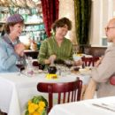 Jane Lynch as 'Dorothy McWilliams', Meryl Streep as 'Julia Child' and Stanley Tucci as 'Paul Child' in Columbia Pictures' JULIE & JULIA.. © 2009 Columbia Pictures Industries, Inc.  All rights reserved.