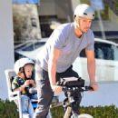Josh Duhamel is spotted enjoying a bicycle ride with his growing son Axl on January 8, 2016 in Brentwood - 454 x 556