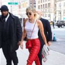 Miley Cyrus – Wears Red Leather Lace Up Biker Pants