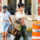 Bella Hadid – In crop top stepping out in New York City