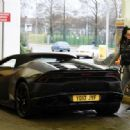 Jemma Lucy in Tights at a gas station in London - 454 x 318