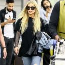 Carmen Electra in Jeans – Arrives at Airport in Miami - 454 x 793