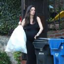 Nicole Trunfio taking out the trash