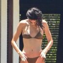 Kendall Jenner and Hailey Bieber – In bikinis relax on pool chairs in Jamaica